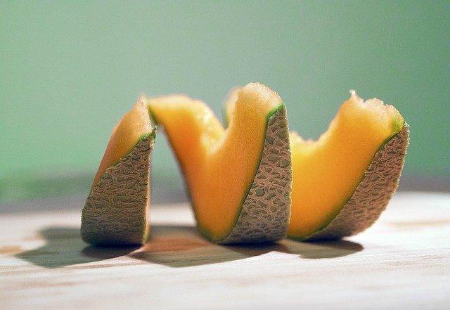 three cantaloupe slices